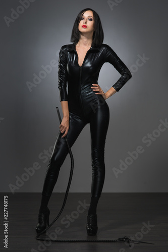Tablou Canvas woman in latex suit on a dark background