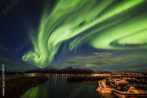 Amazing view of aurora borealis ( northern lights) over Norvegian sea .