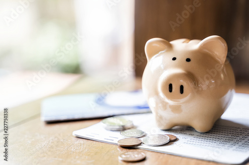 Photo Piggy bank with coins and saving book bank