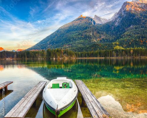 Fantastic autumn evening at Hintersee lake. Few boats on the lake
