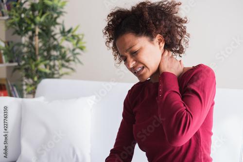 Carta da parati Young black woman suffer shoulder and neck pain