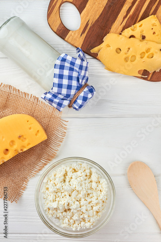 Assorted dairy products, top view. Old-fashioned bottle of milk, cottage cheese and swiss cheese. Only organic food.