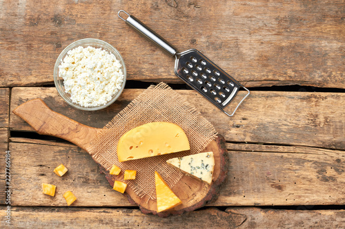 Foto op Aluminium Zuivelproducten Fresh dairy products, top view. Cheese platter on rustic wood and copy space. Organic milk food.