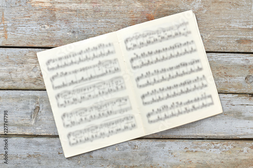 Musical notes book on rustic background Wallpaper Mural