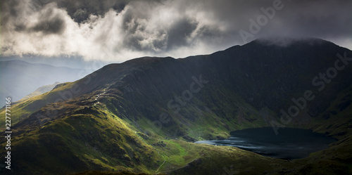 Foto auf Leinwand Blaue Nacht Cadair Idris in Snowdonia National Park, Wales, Uk, just before a storm front came rolling in
