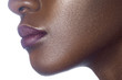 Lips of young beautiful black woman with clean perfect skin