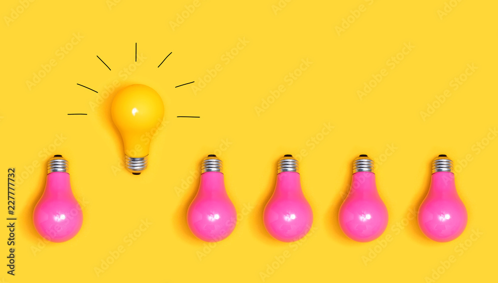 Fototapeta One outstanding idea concept with yellow and pink light bulbs
