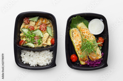 Set of take away difhes in black containers