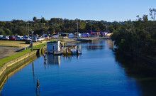 View Of Blue River With Boat Hire Dock
