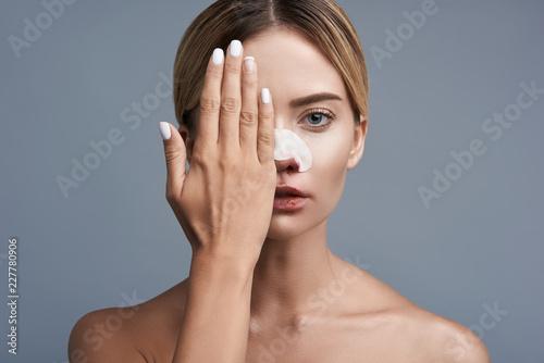 Fotografie, Obraz  Closing one eye