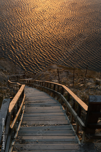 steep descent to the sea. wooden steps. sunset