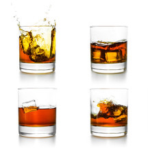 Three Glasses With Whiskey Pouring Into Them