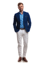 Happy Young Smart Casual Man Standing With Hands In Pockets