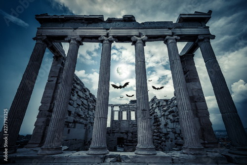 Fotobehang Bedehuis Erechtheion temple on Halloween in full moon, Athens, Greece