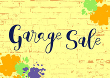 Calligraphy Lettering Of Garage Sale In Dark Blue On Yellow Brick Wall Textured Background Decorated With Paints For Advertising, Invitation, Banner, Poster, Flyer, Handbill