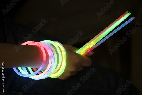 Fotografie, Obraz  glow sticks with hand