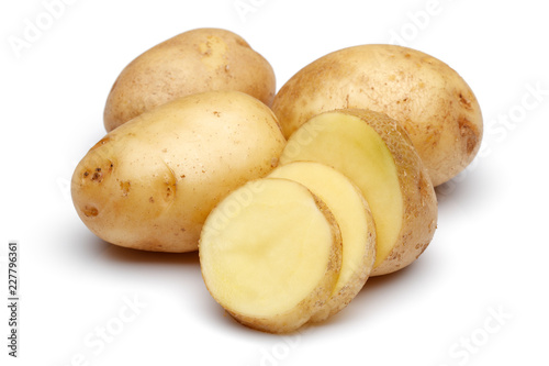 Potatoes with slices isolated on white background