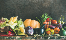 Fall Vegetarian Food Ingredient Variety. Assortment Of Various Autumn Vegetables For Healthy Cooking Over Rustic Cupboard, Dark Wall Background, Copy Space. Local Market Organic Produce