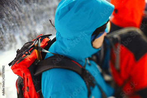 Foto op Plexiglas Alpinisme Ice ax strapped on a backpack climber closeup. Tilt-shift effect.