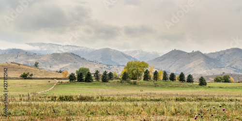 Snow clouds over foothills and farmland