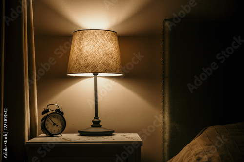 Photo night light and alarm clock on the bedside table