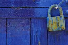 Padlock On Blue Old Wooden Door