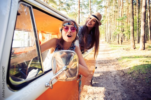 Fototapeta Hipster friends on road trip on a summers day