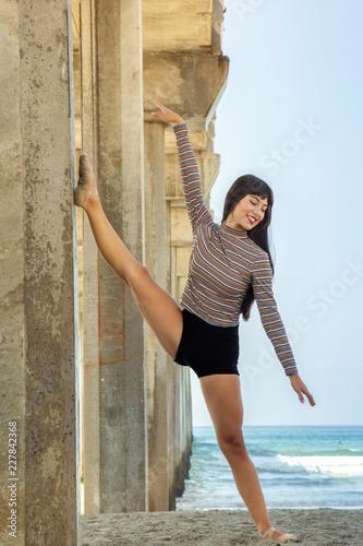 Fotografie, Obraz  Flexible Ballerina With Leg Against the Pier