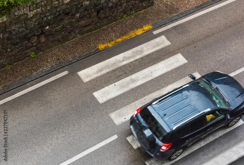 Canvas Print Car passing over zebra crossing stripes