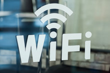 Closeup Of Wifi Logo On Cafe W...