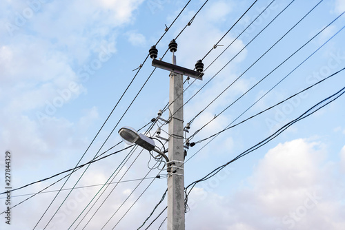 Excellent Lots Of Wires And Cables And A Street Lamp With A Blue Sky Wiring Digital Resources Instshebarightsorg