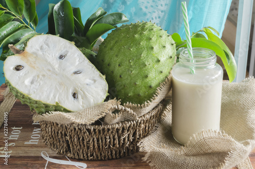 Fototapeta Soursop (also graviola, guyabano, and in Latin America, guanábana) is the fruit