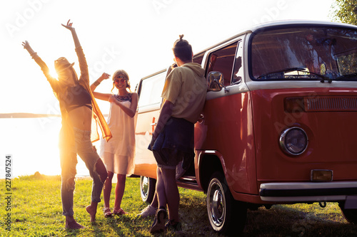 summer holidays, road trip, vacation, travel and people concept - smiling young Wallpaper Mural