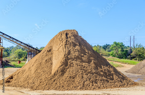 Mound of tan sand: Mound of tan sand used for landscaping and driveways on  display and for sale. - Buy this stock photo and explore similar images at  Adobe Stock | Adobe Stock