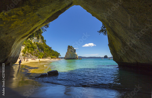 Landscape View through rock arch towards Te Hoho Rock at Cathedral Cove, Coromandel Peninsula - New Zealand