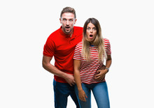Young Couple In Love Over Isolated Background Afraid And Shocked With Surprise Expression, Fear And Excited Face.