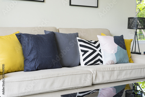 Modern Pattern Blue And Yellow Cushion On Grey Sofa In Living Room