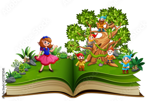 Fotografía Open book with dwarf cartoon on the trees and the snow white