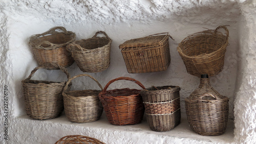 Fotografija Handmade baskets on display in limestone cave alcove