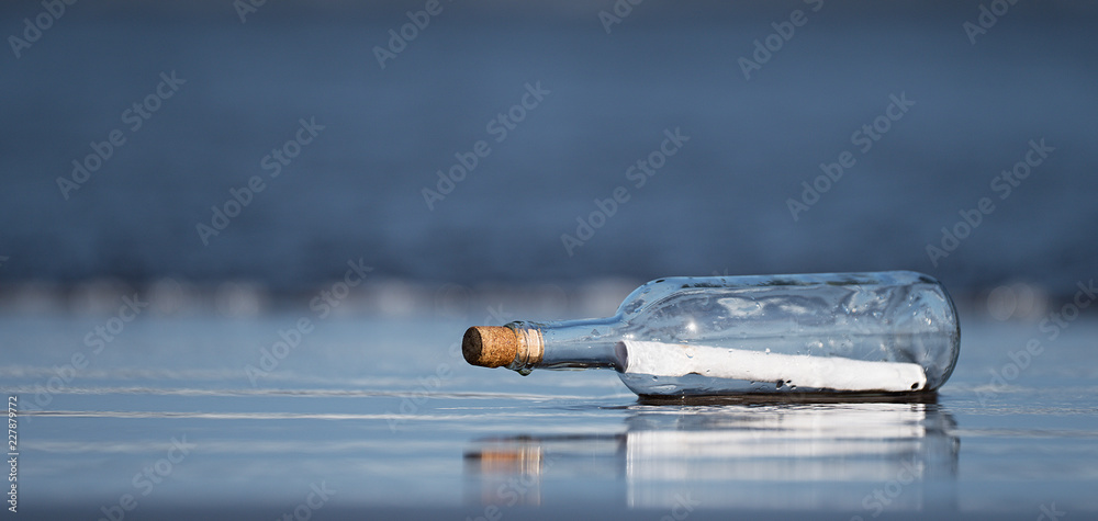 Fototapety, obrazy: Message in a bottle found on the beach