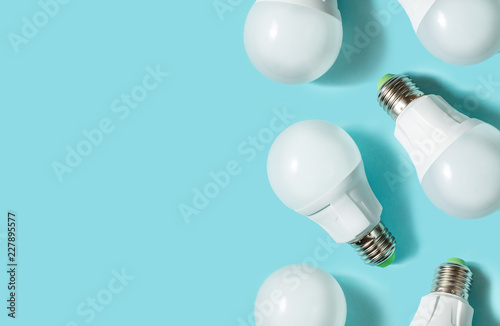 LED light bulbs on blue color background. Flat lay. Pattern.