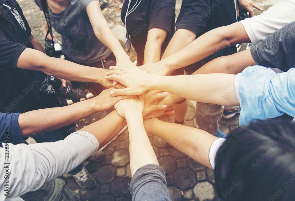 Fototapeta Volunteer Leader effective is key to success. Team Charity group of people giving thump up hands together. Volunteer Spirit Team Members.  Volunteer Leader Concept.