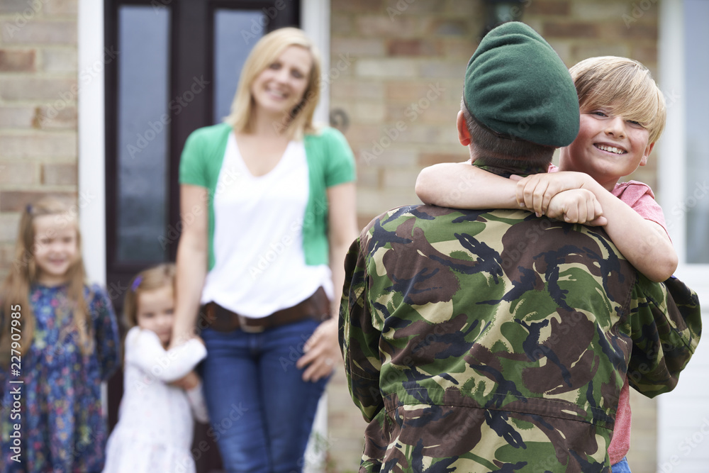 Fototapeta Son Greeting Military Father On Leave At Home