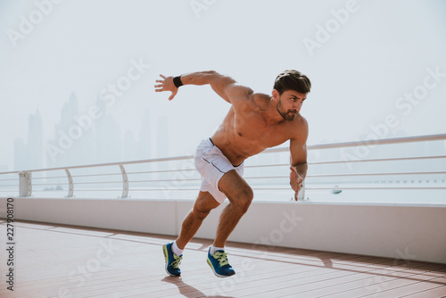Beautiful man doing work out and different exercises outdoor Fototapeta