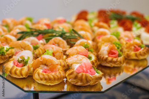 Foto op Canvas Buffet, Bar Delicious catering canapes on a buffet table