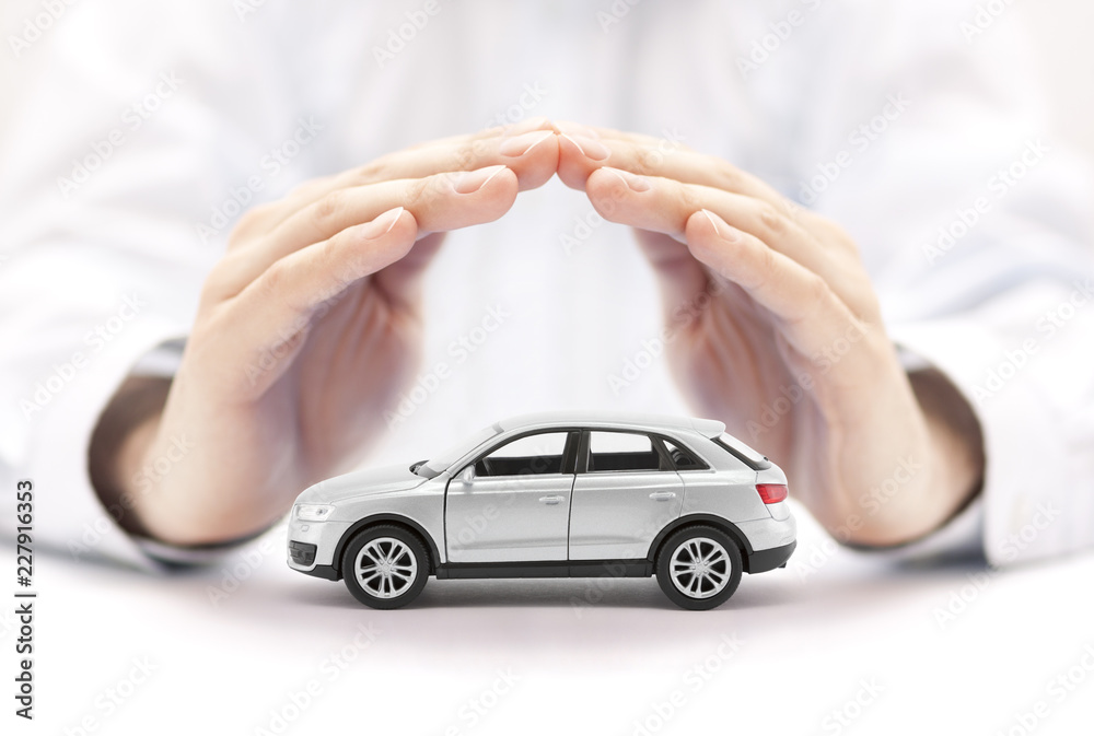 Fototapety, obrazy: Car insurance. Small silver car covered by hands.