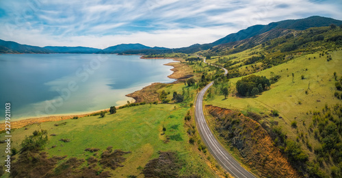 Poster de jardin Vue aerienne Road winding through lake shore and mountains. Scenic aerial panorama of Australia
