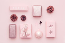 Pastel Pink Minimal Christmas Background. Beautiful Nordic Christmas Gifts Isolated On Pastel Pink Background. Pink Colored Wrapped Xmas Boxes Composition.