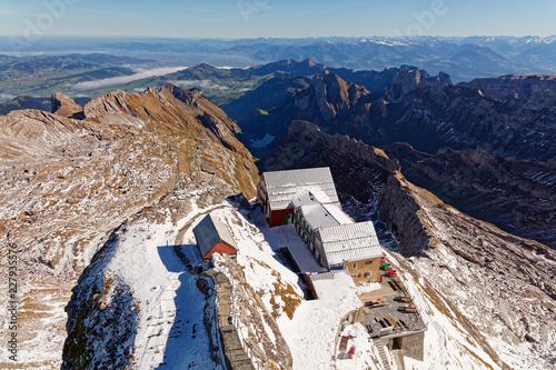 Sunny, first snow, views from Säntis towards restaurant Alter Säntis, Appenzell, Switzerland