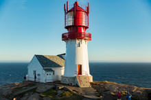 Old Lighthouse Lindesnes Fyr Is A Coastal Lighthouse Located On The Southernmost Point Of Continental Norway In Lindesnes, South Cape. Serene Scandinavian Landscape, Rocky Mountains, Fjord, Sunset Sky
